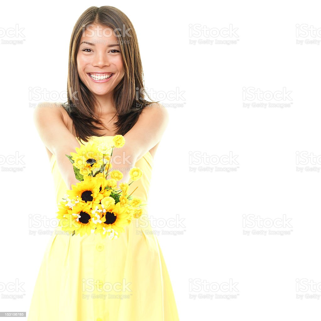 Summer girl showing yellow flowers royalty-free stock photo