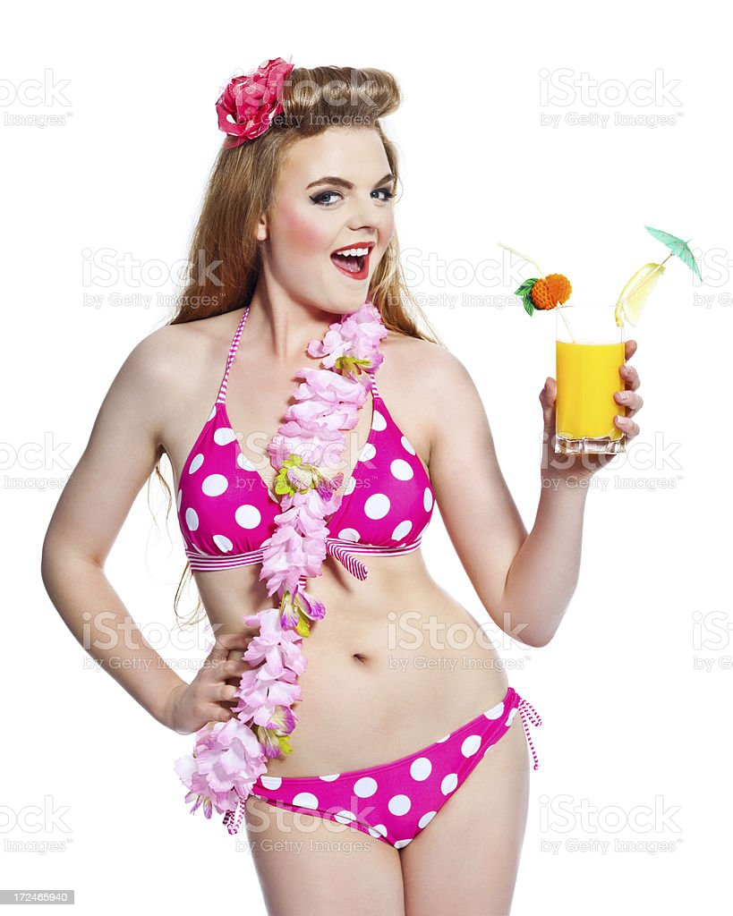 Summer Girl, Studio Portrait Portrait of excited young woman wearing bikini and flower garlands, holding orange juice in hand and laughing at camera. Studio shot on white background. 18-19 Years Stock Photo