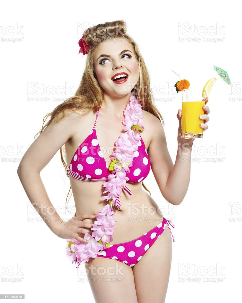 Summer Girl with Orange Juice, Studio Portrait Portrait of excited young woman wearing bikini and flower garlands, holding orange juice in hand. Studio shot on white background. 18-19 Years Stock Photo
