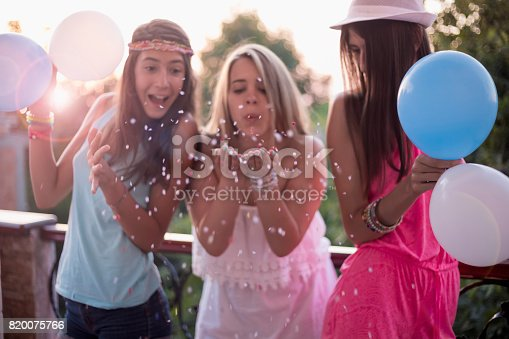 istock Summer girls party on balcony 820075766