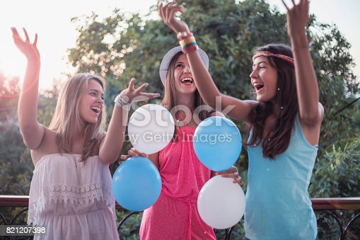 istock Summer girls party on balcony 821207398