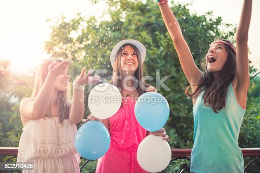 istock Summer girls party on balcony 822910406