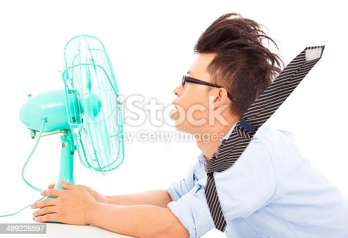 istock Summer heat, business man use fans to cool down 499226597