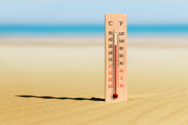 Summer heat. Thermometer on the beach shows plus 34 degrees celsius. Summer travels and holidays stock photo