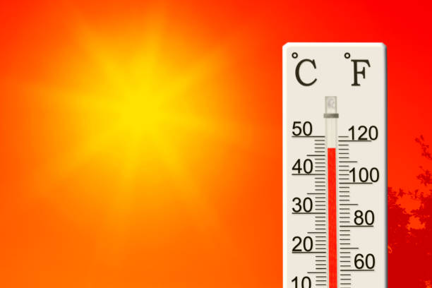 Summer heat. Thermometer shows high temperature in summer stock photo