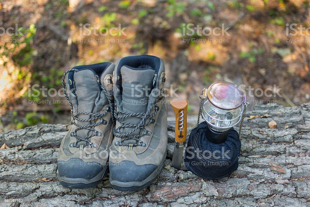 Summer hiking in the mountains with a tent and equipment. royalty-free stock photo