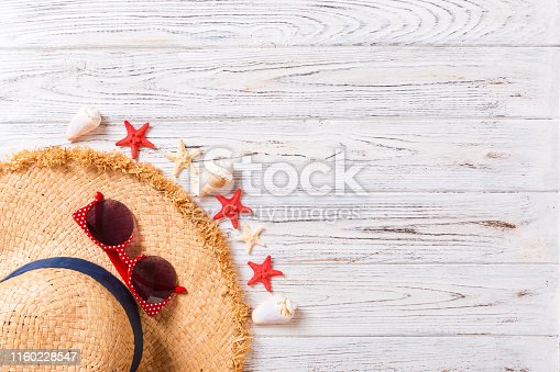 699960484istockphoto summer holiday beach background with accessories on wooden table, top view with copy space. vacation concept 1160228547