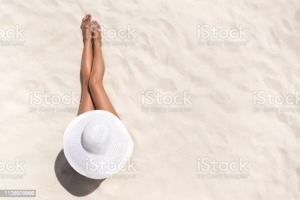 Summer holiday fashion concept tanning woman wearing sun hat at the picture id1128929966?b=1&k=6&m=1128929966&s=612x612&h=mleywvkqjvj7jxpzonn8pc s7ohotoby76zqkp8zhgw=
