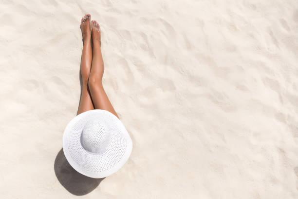 Summer holiday fashion concept tanning woman wearing sun hat at the picture id1128929966?b=1&k=6&m=1128929966&s=612x612&w=0&h=h4 jxvx8tggi panxkfqx1stjsfvdjazoss1lpfkptg=