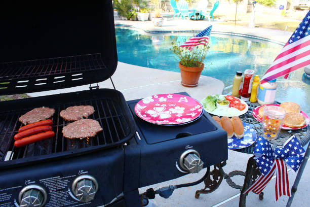 summer holiday grilling - memorial day stock photos and pictures