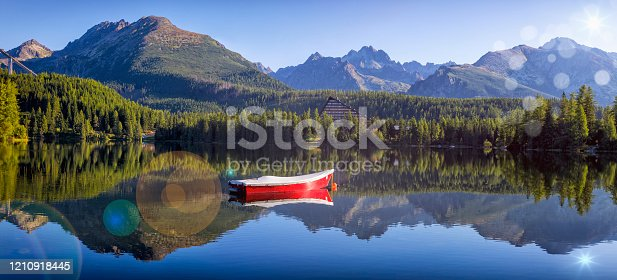istock Summer holiday morning at the Strbske Pleso mountain lake, Slovakia 1210918445