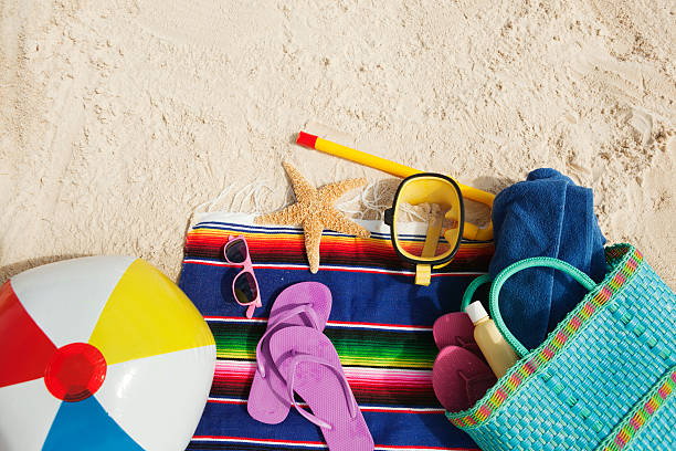summer holiday vacation beach bag and fun supply and toy - beach ball stock photos and pictures