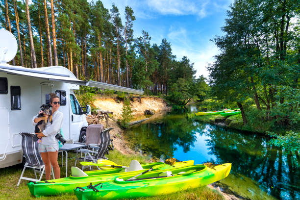 Summer holiday with a canoe in Poland Holiday with a canoe in Wda river, Kashubian region, Poland motor home stock pictures, royalty-free photos & images
