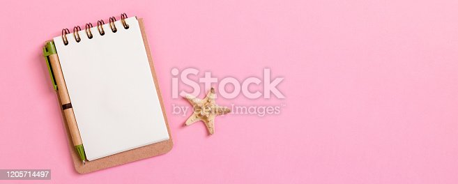 936373320 istock photo Summer holidays concept banner . travel background with notepad and starfish . Top view. Flat lay 1205714497