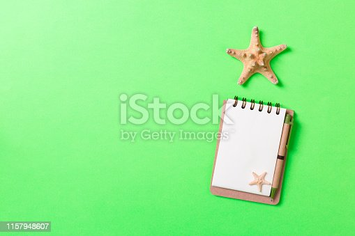 936373320 istock photo Summer holidays concept. travel background with notepad and starfish . Top view. Flat lay 1157948607