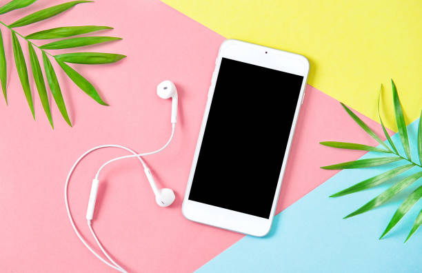 summer holidays flat lay mobile phone headphones - summer background стоковые фото и изображения