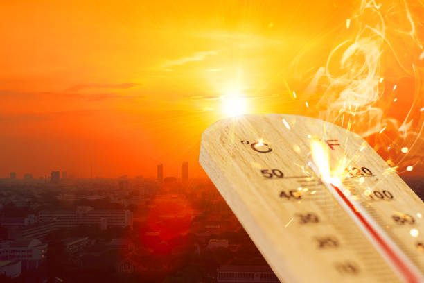 summer hot weather season high temperature thermometer with city view. stock photo