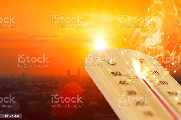 Photo of summer hot weather season high temperature thermometer with city view.