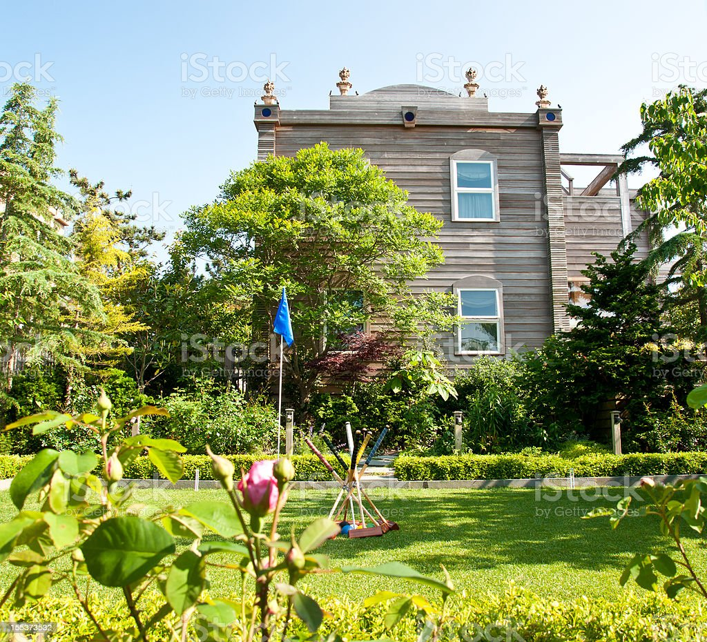Summer House with Rose Garden and Croquet Lawn royalty-free stock photo