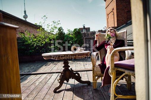 Relaxing, beauty, cute, vintage, art, portrait, balcony, fun, East-Berlin, young woman, bizarre, funky, Trumpet, music, summer, outdoors,