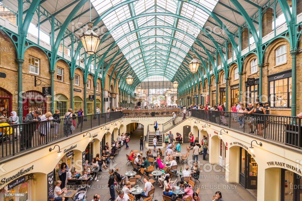 Summer in Covent garden, one of the biggest flea market in UK LONDON, UK - July 20, 2018: Summer in Covent garden, one of the biggest flea market in UK Architecture Stock Photo