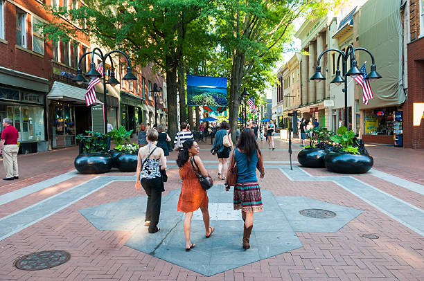 Summer in downtown Charlottesville Charlottesville, Virginia, USA - June 7, 2012: Pedestrians enjoy a beautiful summer afternoon in downtown Charlottesville. charlottesville stock pictures, royalty-free photos & images