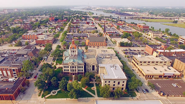 summer in green bay wisconsin, downtown aerial with courthouse. - green bay wisconsin stock photos and pictures