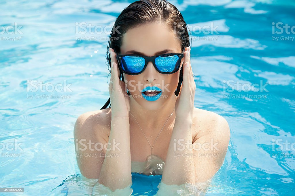 summer in pool stock photo