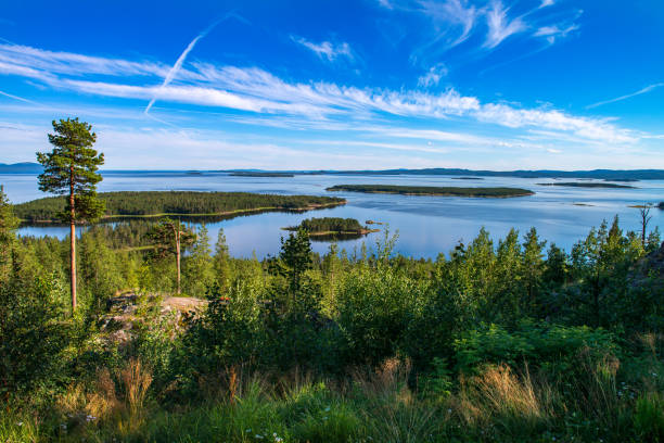 Summer in the Arctic. Beautiful views Kandalakshsky Bay in the White sea Summer in the Arctic. Beautiful views Kandalakshsky Bay in the White sea. In the sky beautiful clouds. In the sea many small Islands republic of karelia russia stock pictures, royalty-free photos & images