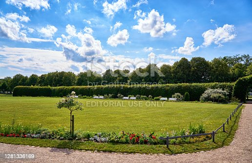 Schwerin, Germany - June 16, 2019: Summer in the castle garden with blue sky and white clouds.