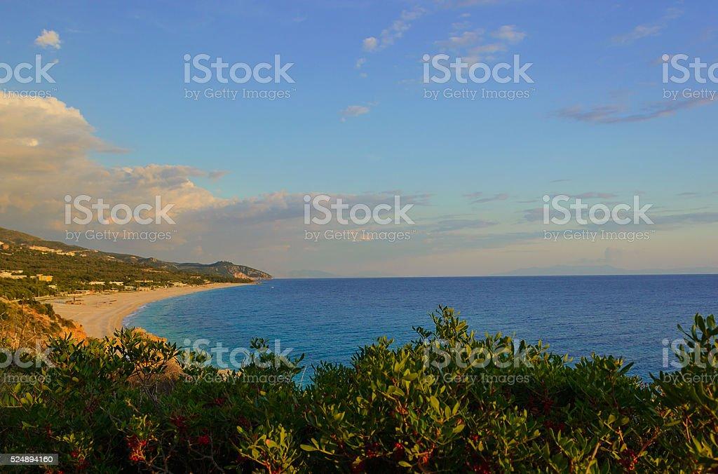 Summer Ionian Sea coastline view  with green bushes, Albania stock photo