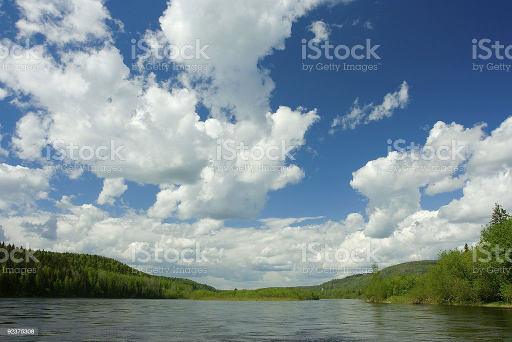 Summer landscape. Clouds above the river. royalty-free stock photo