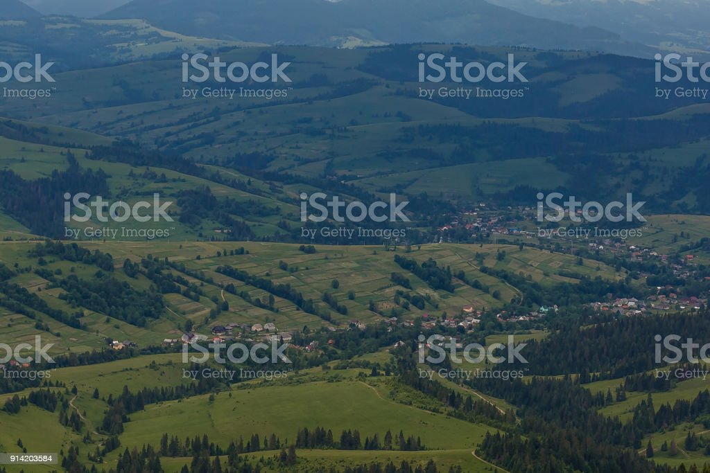 Summer landscape in mountains and the dark blue sky with clouds. storm stock photo