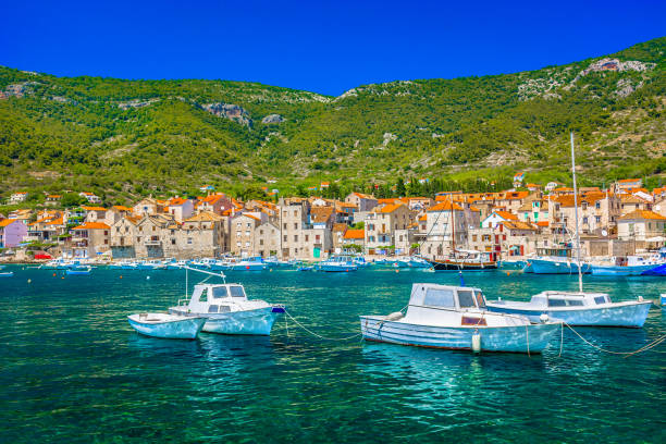 Summer landscape Komiza Vis. Seafront view at colorful adriatic scenery in town Komiza, famous croatian summer resort on Island Vis. croatian culture stock pictures, royalty-free photos & images