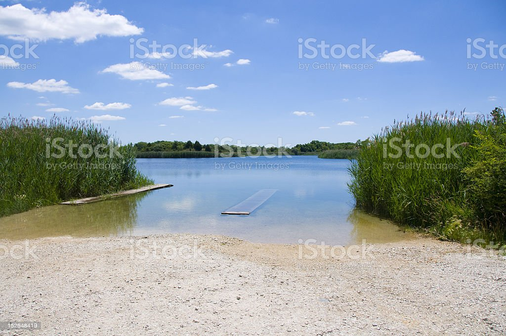 Summer landscape of pond with blue sky royalty-free stock photo