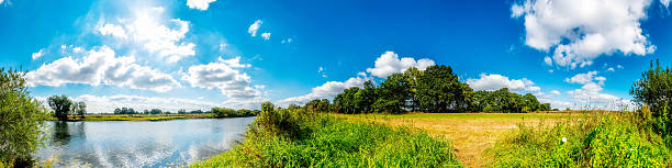 Summer landscape Panorama of a summer landscape with a river lower saxony stock pictures, royalty-free photos & images