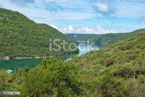 Summer landscape. View of the mountains and the Limsky channel (Limsky fjord). Croatia