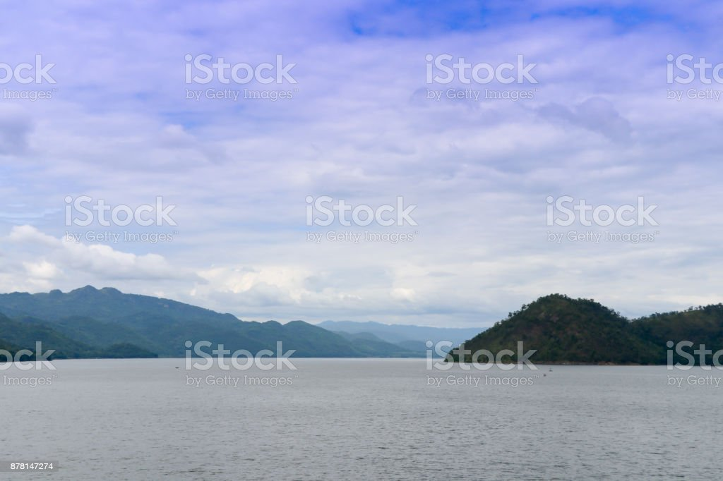 Summer landscape water in dam blue sky with mountain  background stock photo