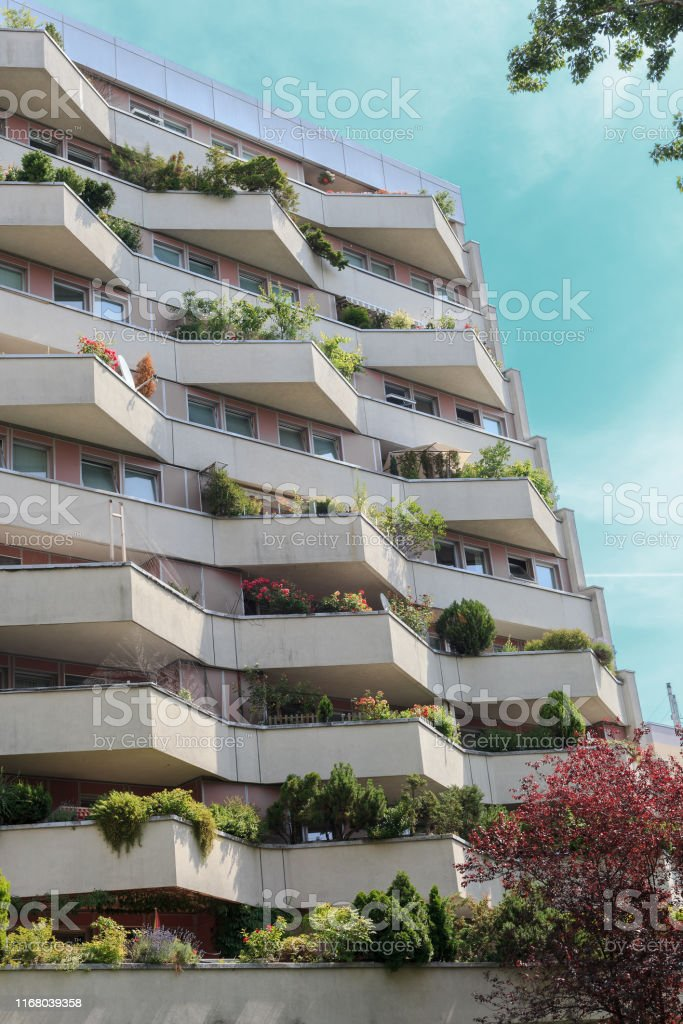 Summer landscape with residential apartment building and balconies...