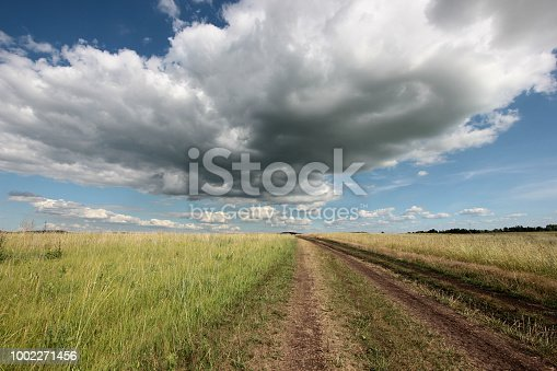 clouds over the road in the field