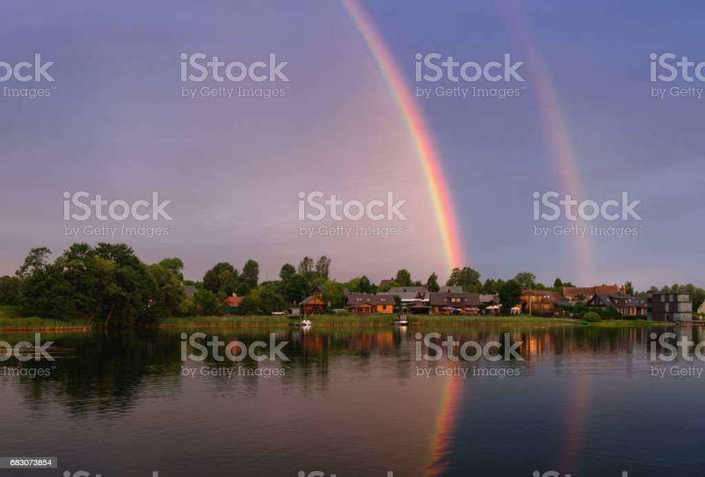 Summer landscape with double rainbow and boats.Rainbow over the lake Galve, near of Trakai Island Castle,  Lithuania. stock photo