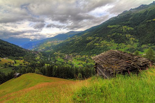 Summer landscape with shed in the swiss alps