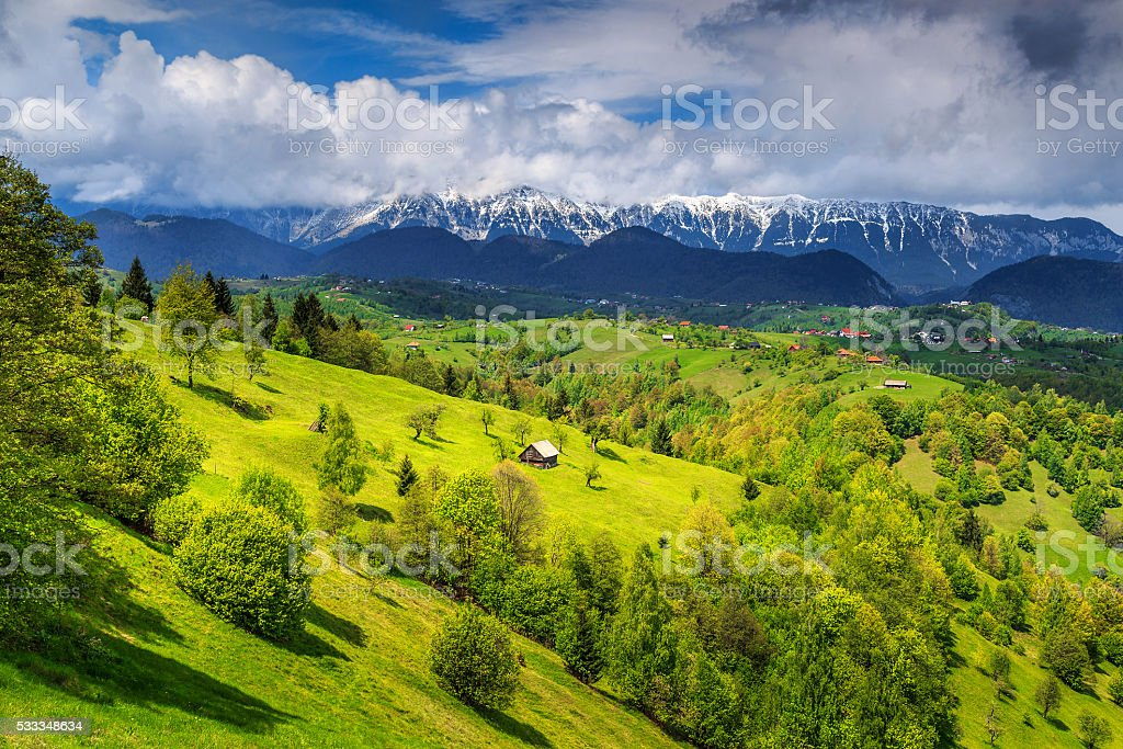 Summer landscape with snowy mountains near Brasov,Transylvania,Romania,Europe stock photo