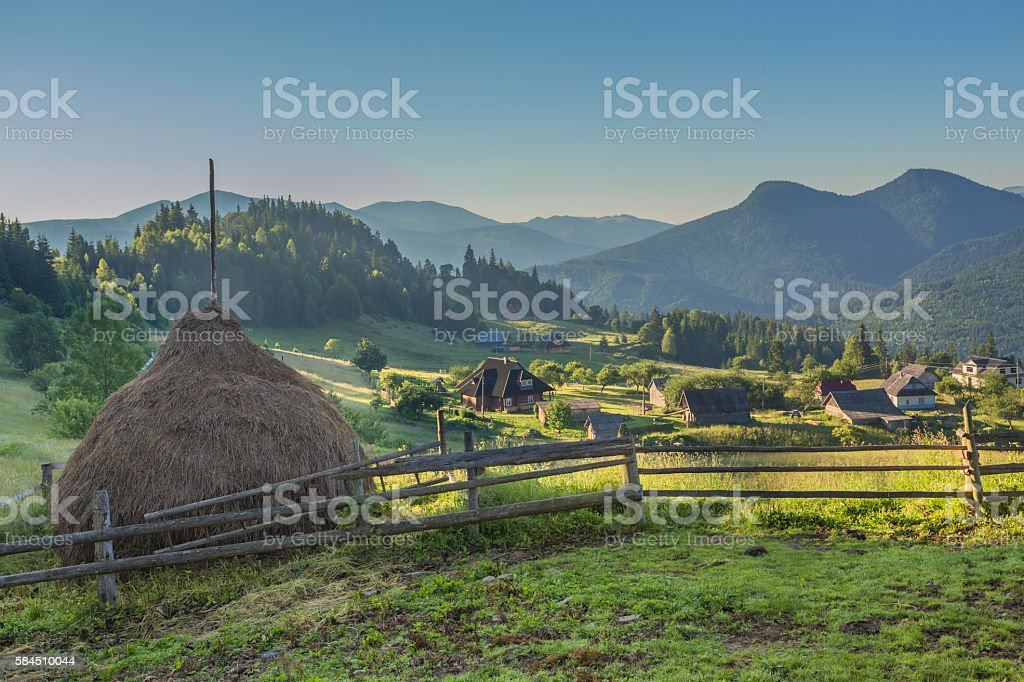 summer landscape with village in mountains stock photo