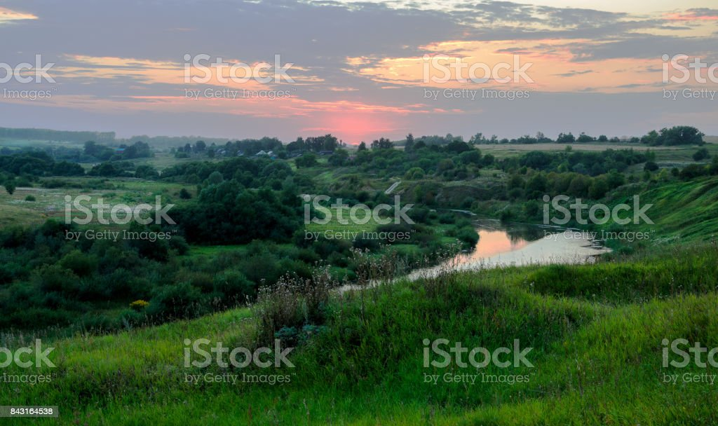 Summer landscape.Colorful sunset over the green fields stock photo