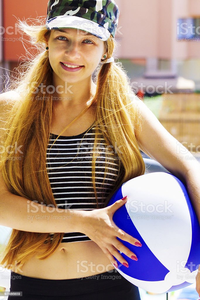 Summer leisure - active happy woman holding a ball royalty-free stock photo