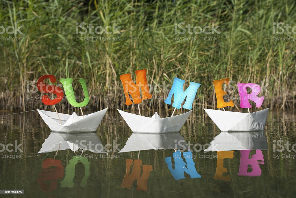 Summer letters on white paper boats royalty-free stock photo