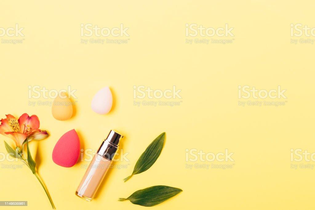 Summer makeup background foundation cream and blending sponges of...