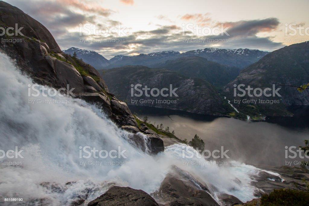 Summer mountain Langfossen waterfall on slope Etne, Norway. stock photo