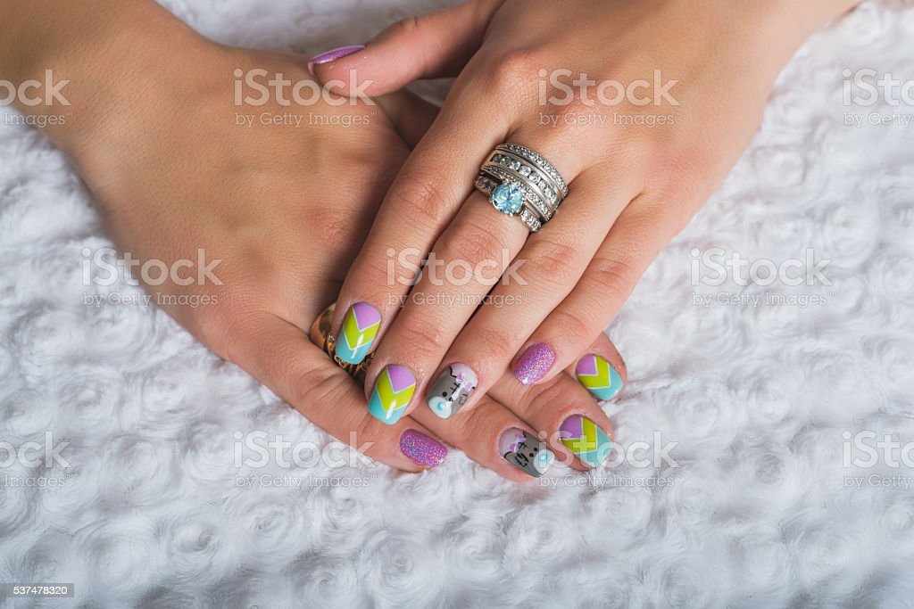 Summer nail art with chevron design with teddy bear picture stock photo